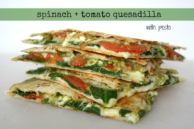 Vegan spinach and tomato pesto quesadillas cut in half