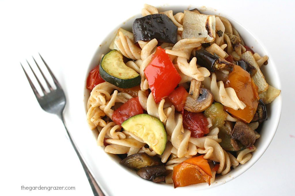 Bowl of roasted vegetable pasta with fork