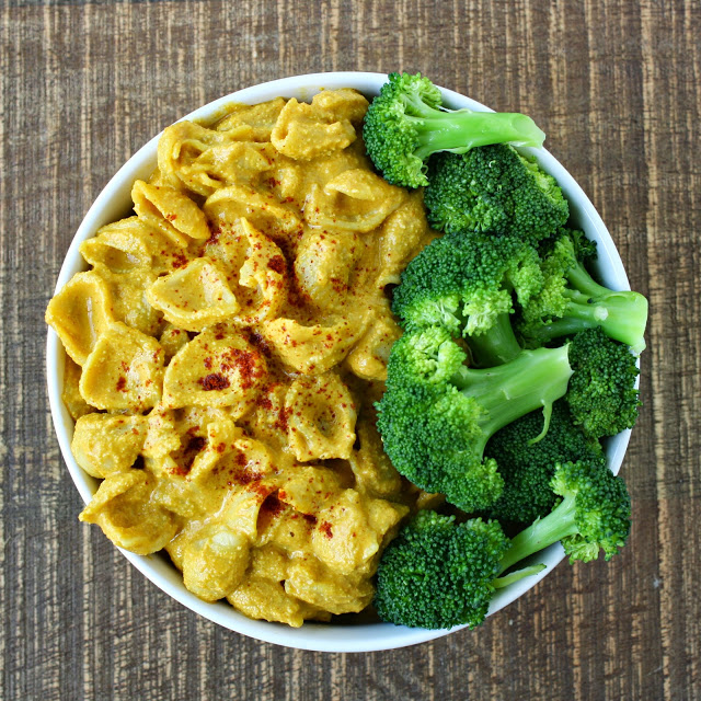 Bowl of vegan mac and cheese with broccoli