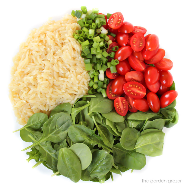 Ingredients for orzo salad with spinach and tomato