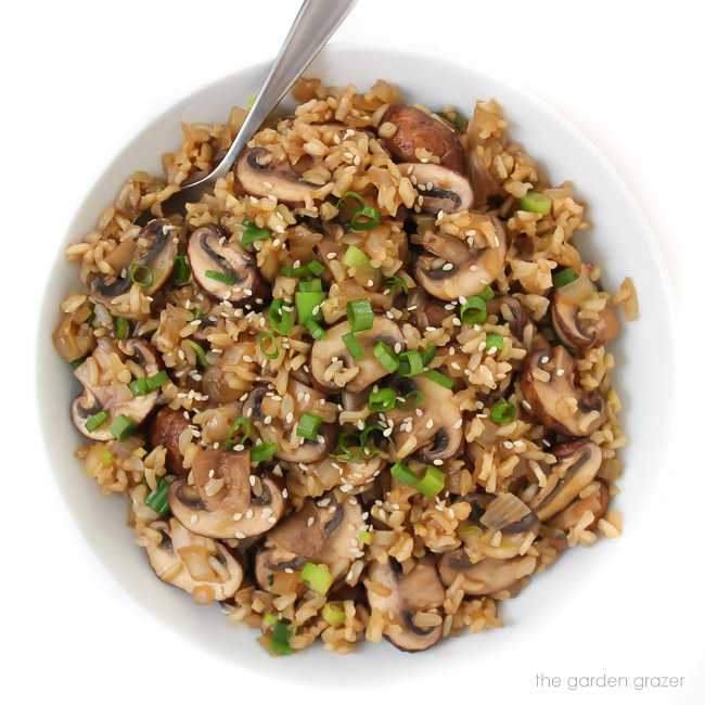 Mushroom rice in a bowl with spoon