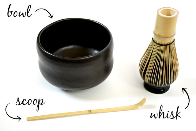 A matcha bowl, a bamboo whisk, and a bamboo scoop for matcha