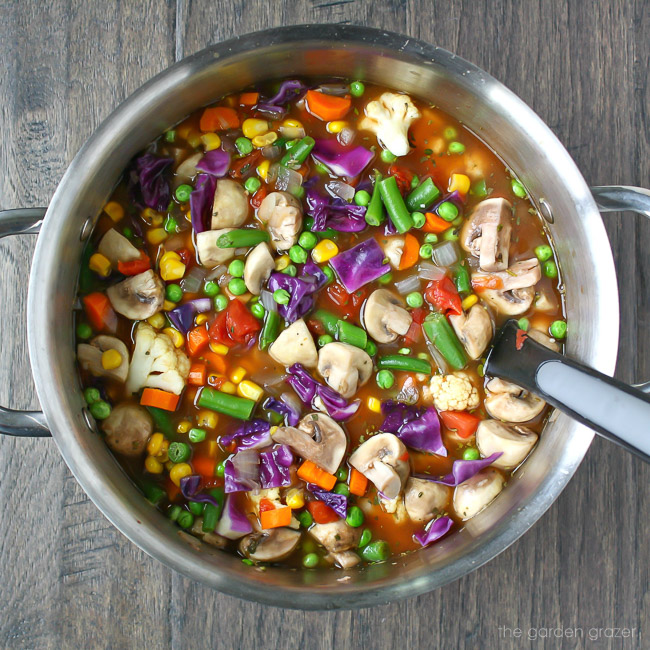 Big pot of colorful vegetable soup